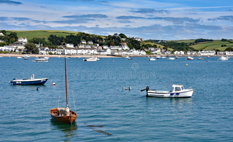 Bideford, North Devon, England. 13th July 2017 - The quay and old bridge in the port of Bideford in North Devon, England, taken from Wooda Wharf looking west royalty free stock images