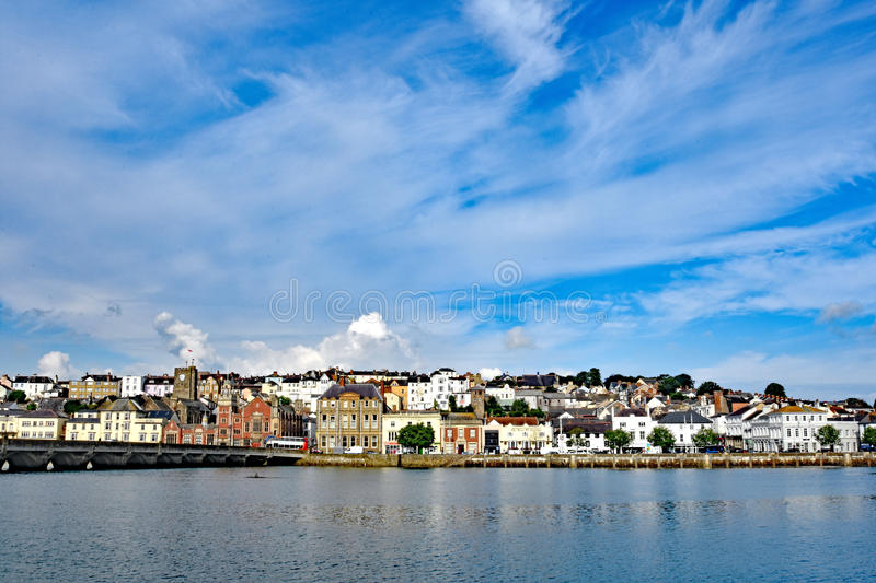 Bideford, North Devon, England. 13th July 2017 - The quay and old bridge in the port of Bideford in North Devon, England, taken from Wooda Wharf looking west royalty free stock photo