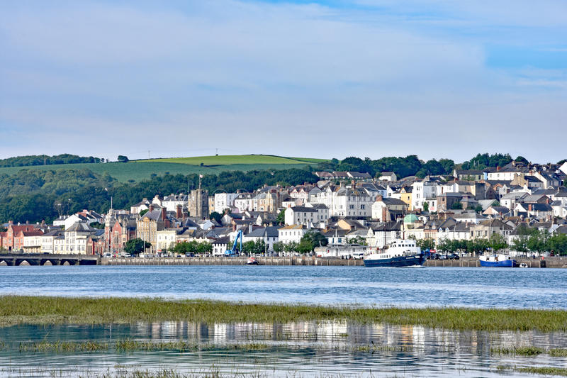 Bideford, North Devon, England. 13th July 2017 - The town and old bridge in the port of Bideford in North Devon, England, looking west across the river Torridge royalty free stock photo