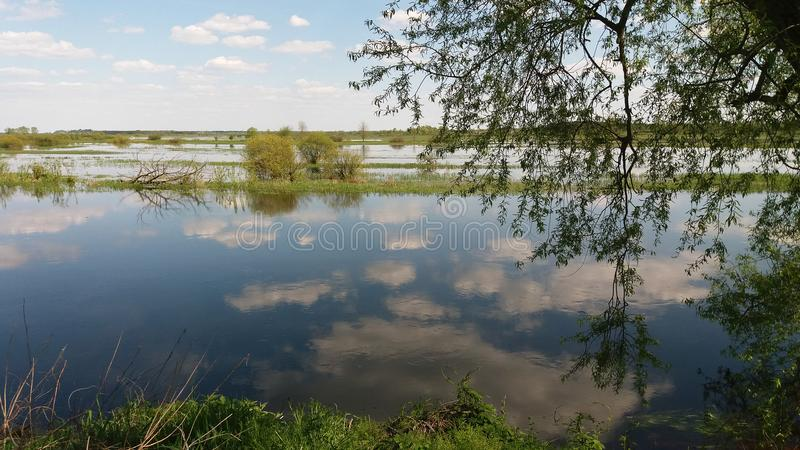 Biebrza spillway in spring. Water in the clouds royalty free stock photo