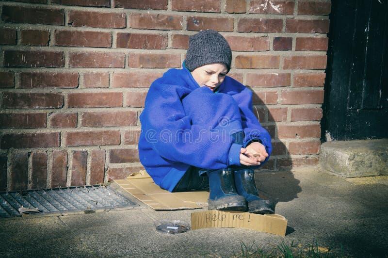 Biedna chłopiec obrazy royalty free