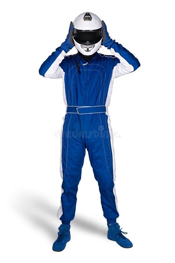Biegowy kierowca w błękitnych białych motorsport kombinezonu butów rękawiczkach i zbawcza przekładnia zdejmujemy trzaska hełm po  obraz stock