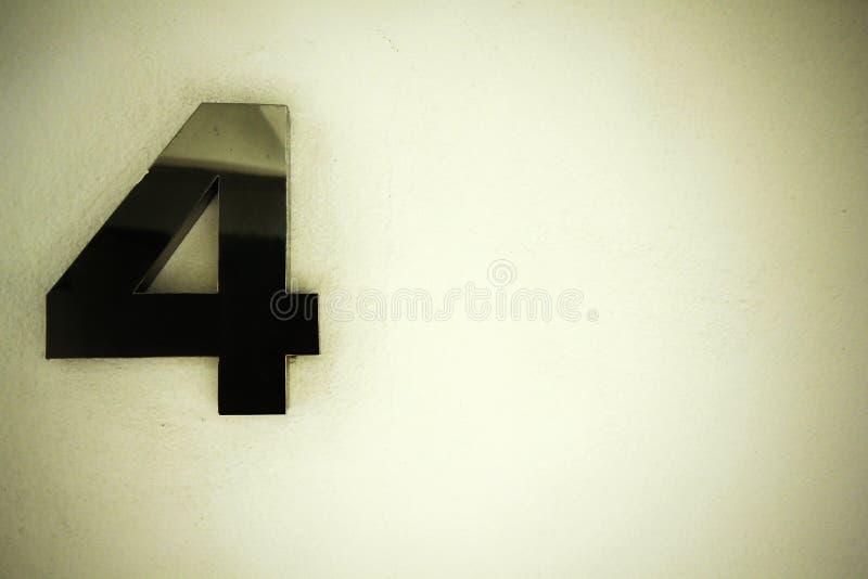 Biel ściana cztery i liczba zdjęcia stock