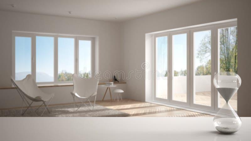 Biel półka z krystalicznym hourglass mierzy przelotnego czas nad nowożytnym żywym pokojem z panoramicznym okno lub stół zdjęcia stock