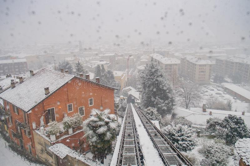 Biella, Piedmont - Italy. Biella, looking down to the town from the funicular station in the higher part of town during the snowfall, the Piazzo royalty free stock images