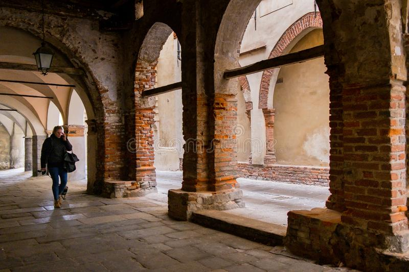 Biella, Piedmont - Italy. BIELLA - MARCH 02, 2015: walking under the portici in the higher part of town, the Piazzo with the medieval streets royalty free stock photography
