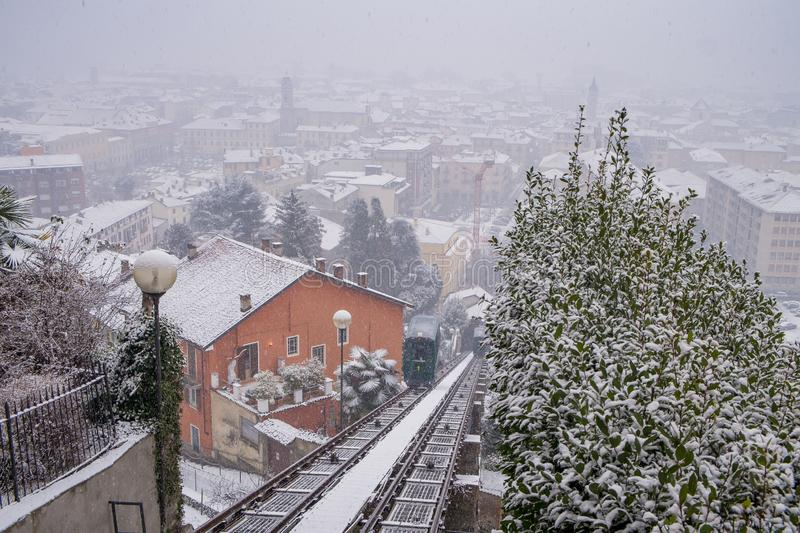 Biella, Piedmont - Italy. Biella, looking down to the town from the funicular station in the higher part of town during the snowfall, the Piazzo royalty free stock photo