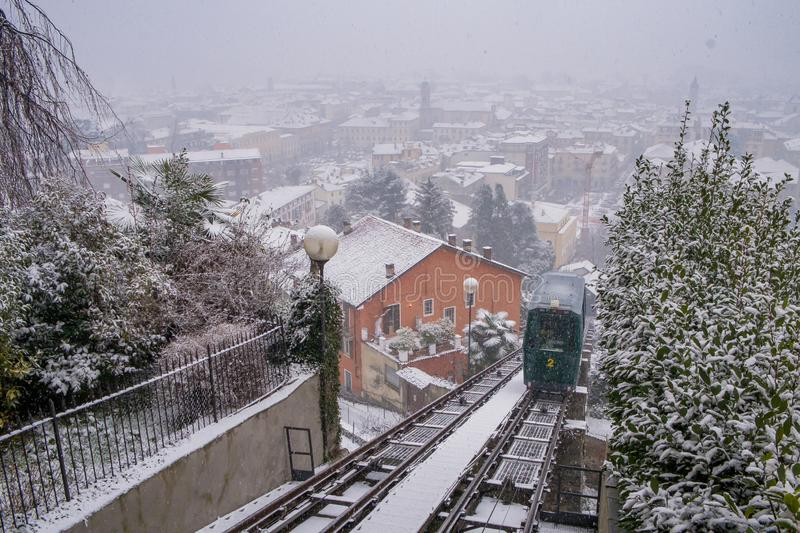Biella, Piedmont - Italy. Biella, looking down to the town from the funicular station in the higher part of town during the snowfall, the Piazzo royalty free stock image