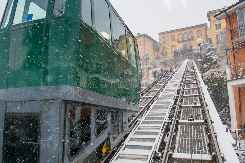 Biella, Piedmont - Italy. Biella, looking down to the town from the funicular station in the higher part of town during the snowfall, the Piazzo stock images