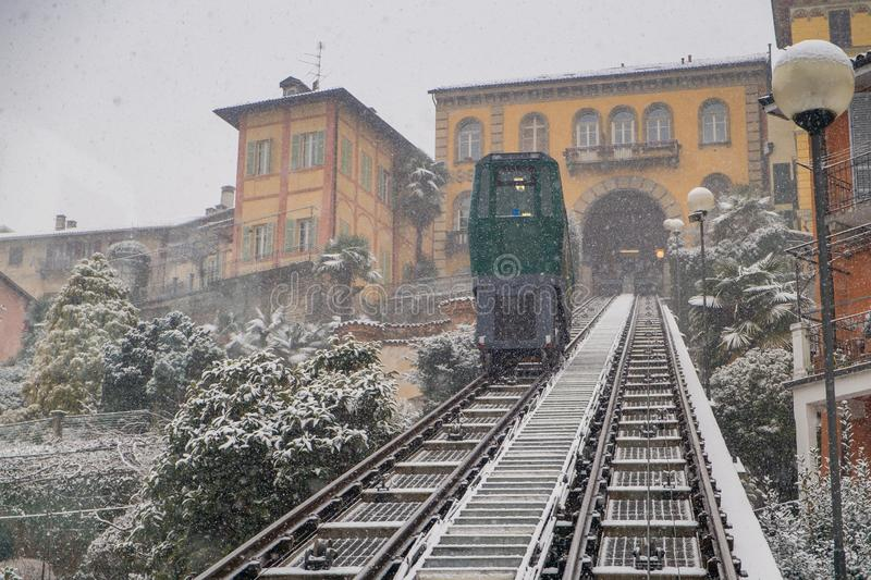 Biella, Piedmont - Italy. Biella, looking down to the town from the funicular station in the higher part of town during the snowfall, the Piazzo stock photo