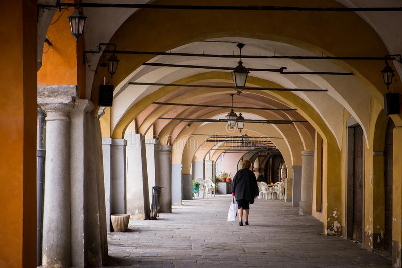Biella, Piedmont - Italy. Biella, walking under the portici in the higher part of town, the Piazzo with the medieval streets royalty free stock image
