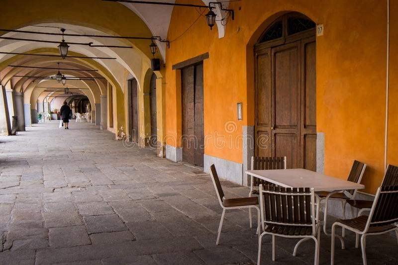 Biella, Piedmont - Italy. Biella, walking under the portici in the higher part of town, the Piazzo with the medieval streets stock images