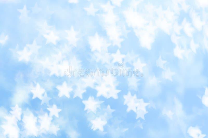 Bielu gwiazdowy bokeh na błękitnym tle zdjęcie royalty free