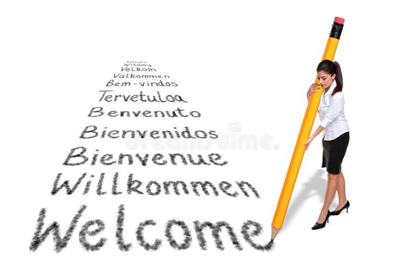 Bienvenue d'écriture de femme d'affaires dans divers langages photos libres de droits