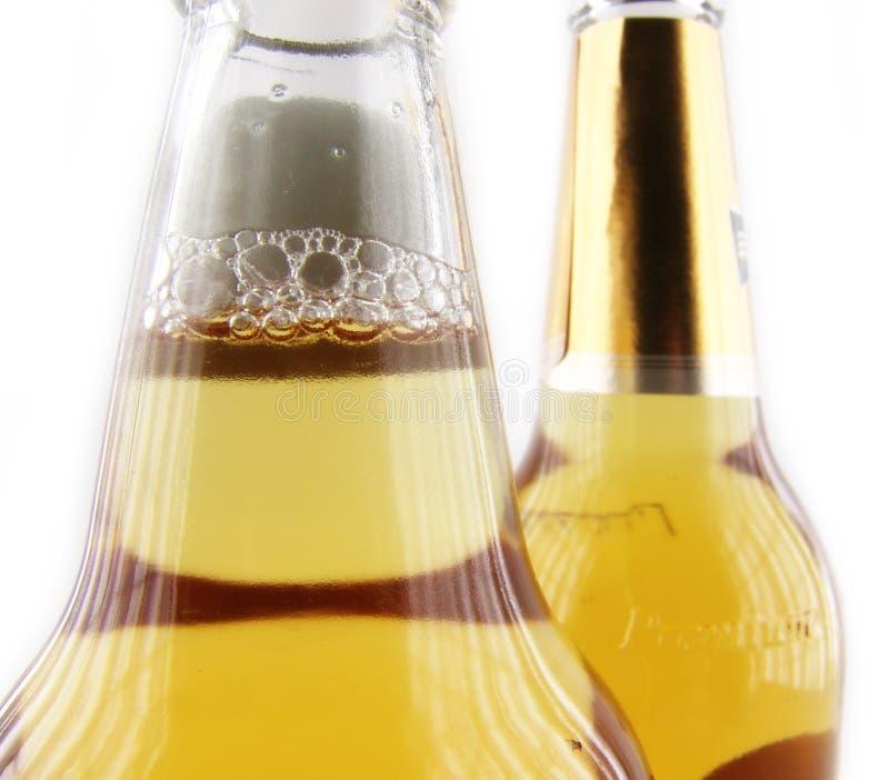 Bier in fles stock afbeeldingen
