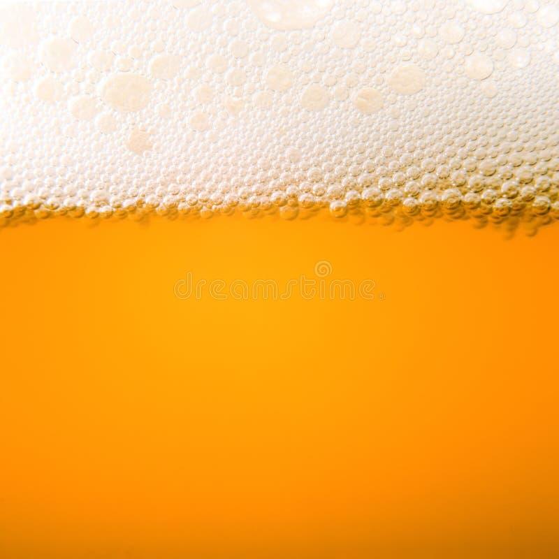 Bierschaum lizenzfreie stockbilder
