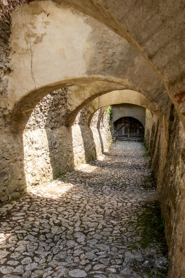 Arches over the cobblestone entrance to the Saxon UNESCO World Heritage Site of Biertan Fortified Church. Sibiu County, Romania. The Biertan fortified church is royalty free stock photos