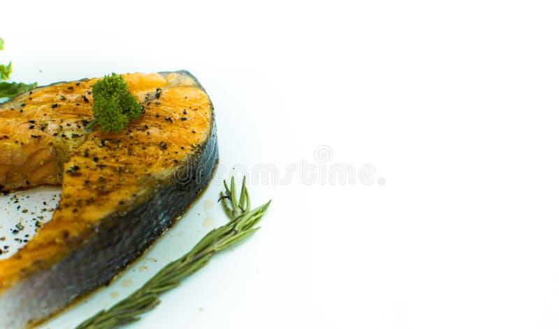 Bife de salmões no fundo branco fotos de stock royalty free
