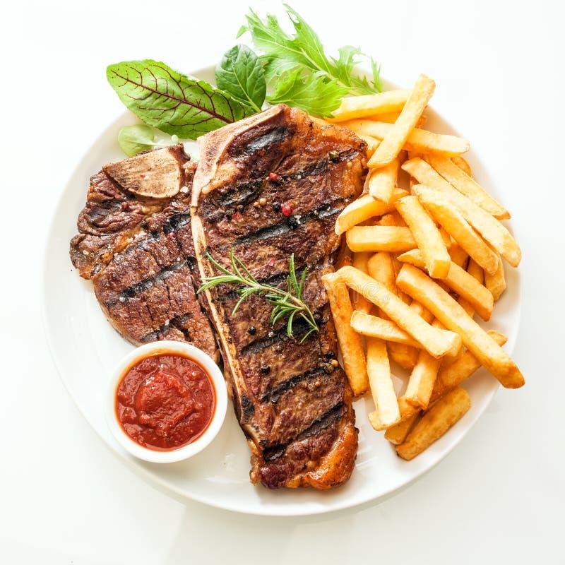 Bife do lombo grelhado temperado com alecrins imagens de stock