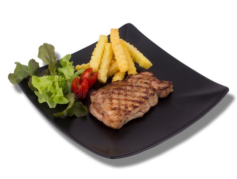 Bife grelhado da carne de porco isolado no fundo branco fotografia de stock royalty free