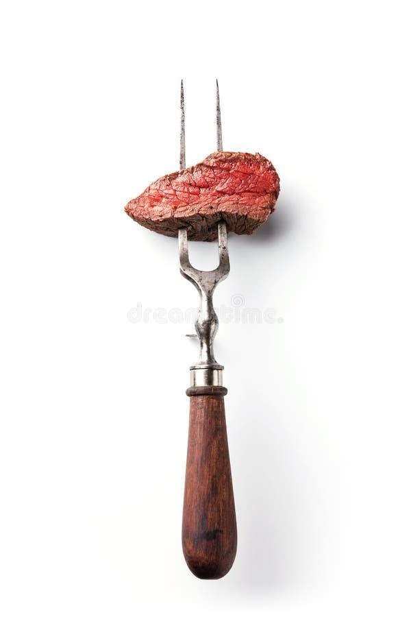 Bife na forquilha da carne imagem de stock