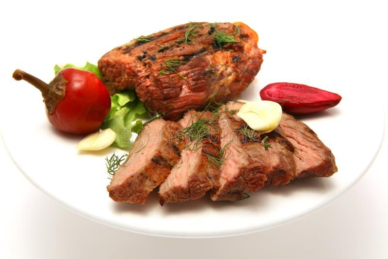 Bife serido da carne no prato foto de stock