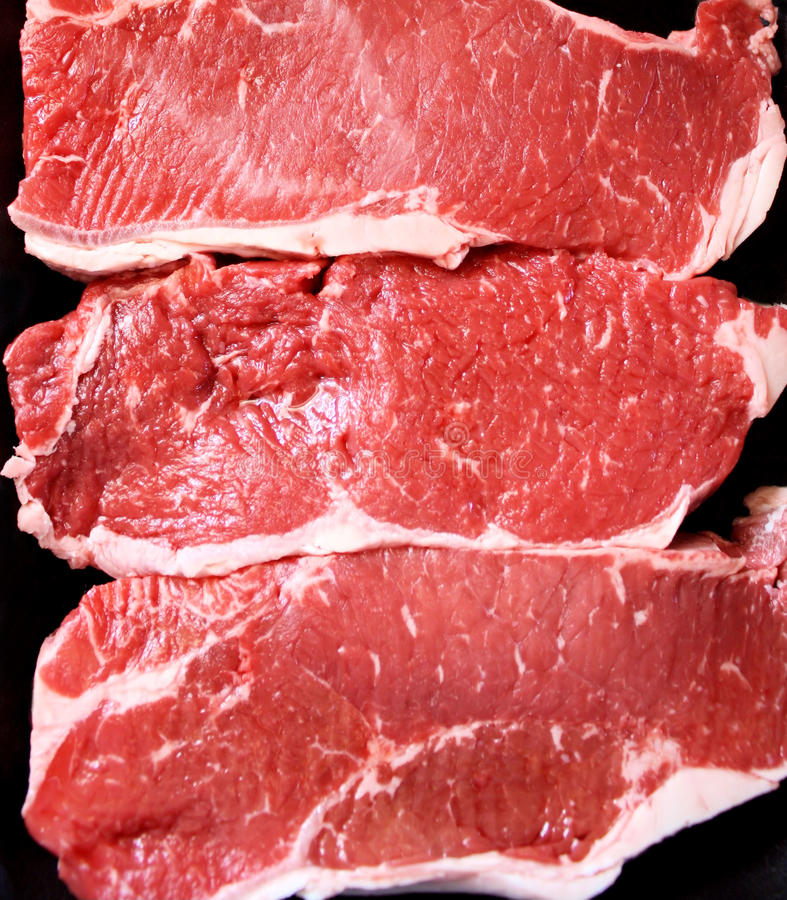 Bifes do Sirloin imagem de stock royalty free