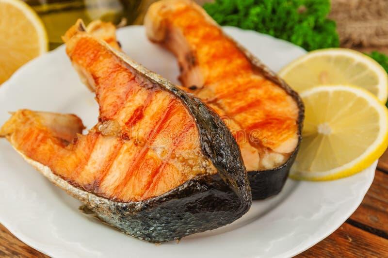 Bifes fritados dos peixes foto de stock royalty free