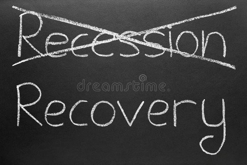 Biffant la récession et écrire la reprise. photos stock