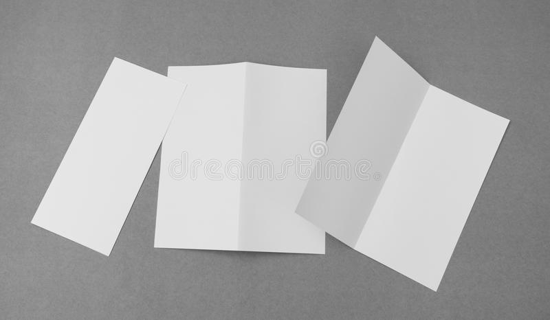 Bifold white template paper on gray background . royalty free stock photos