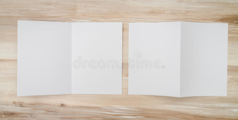 .Bifold white template paper on wood texture royalty free stock photos