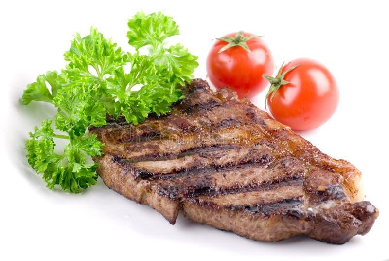 Bifteck avec le persil image stock