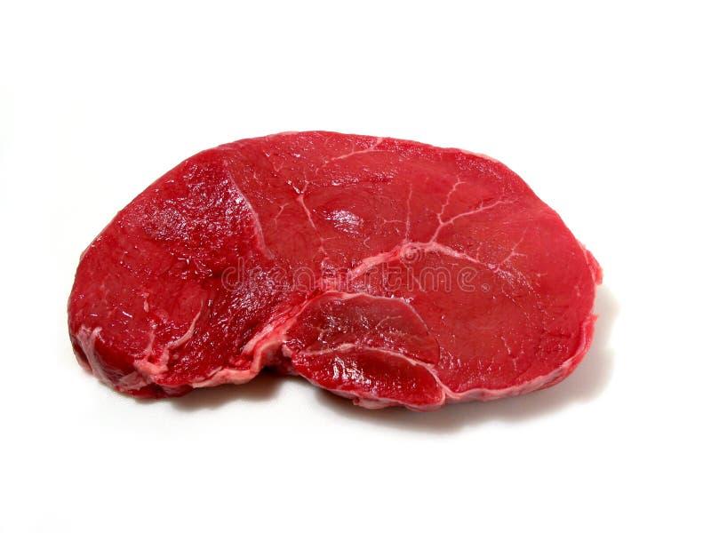 Bifteck cru sur le fond blanc photos stock