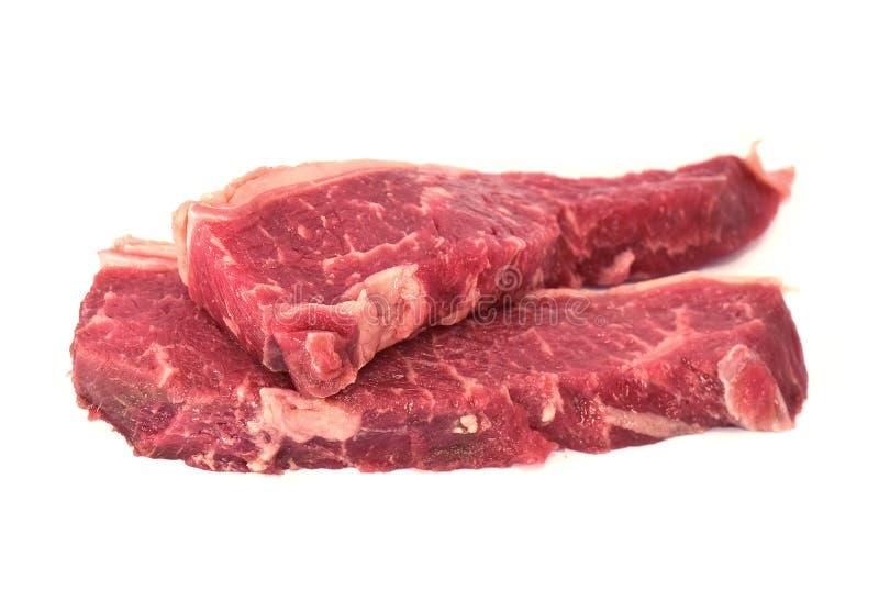 Bifteck d'aloyau cru de boeuf photo stock
