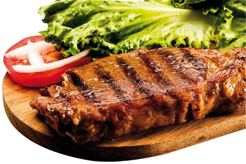 Bifteck d'aloyau grillé à bord photos libres de droits