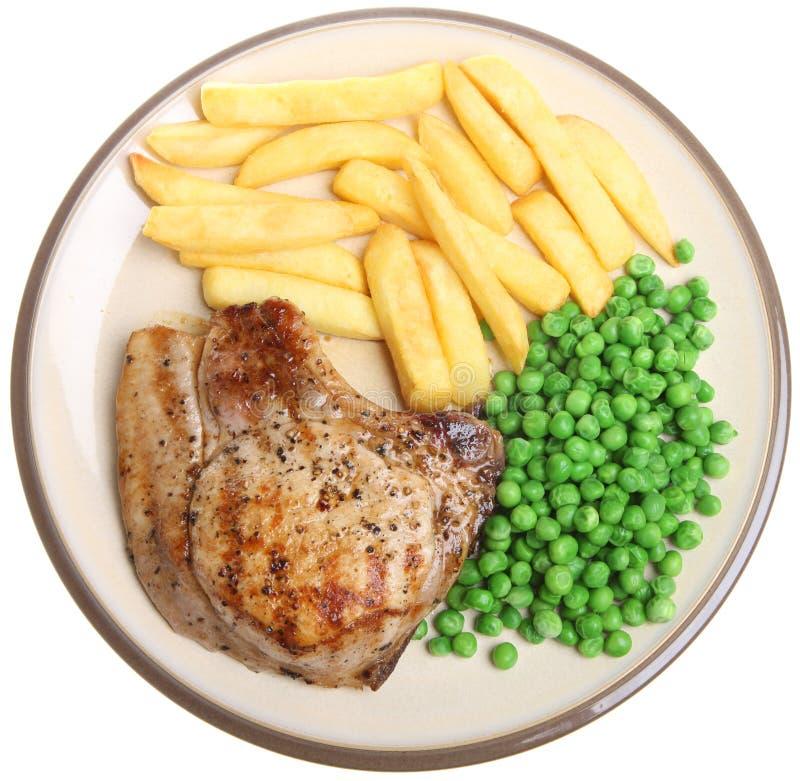 Bifteck de porc avec des frites et des becs d'ancre photos stock