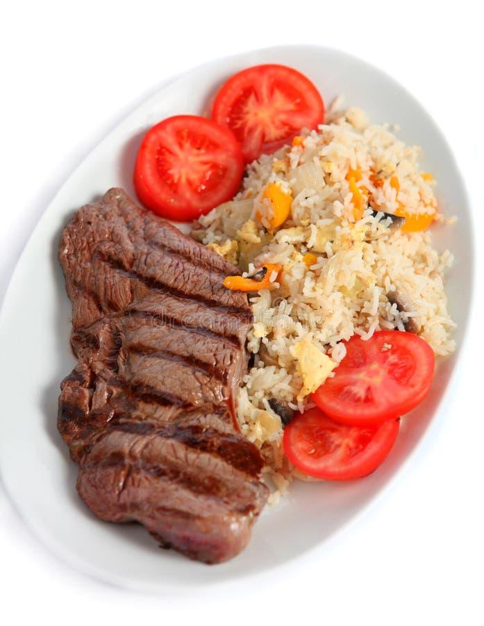 Bifteck et riz frit images stock