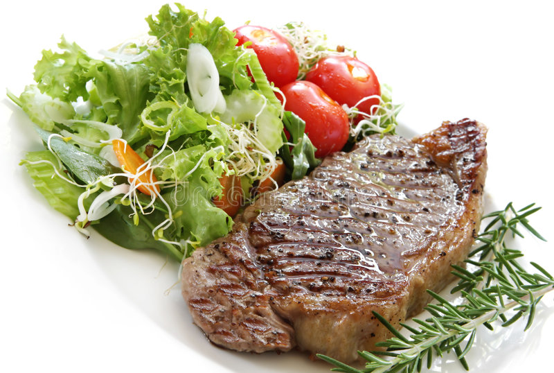 Bifteck et salade photographie stock libre de droits
