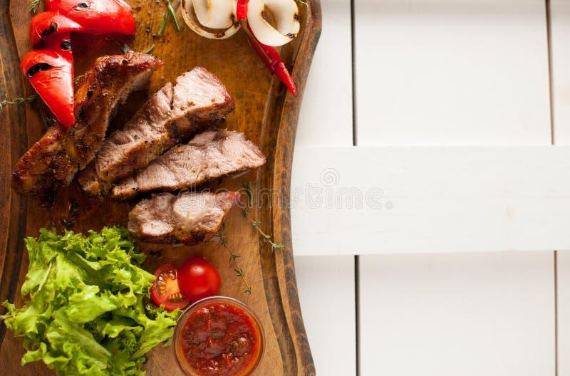 Bifteck grillé de cou de porc sliced images libres de droits