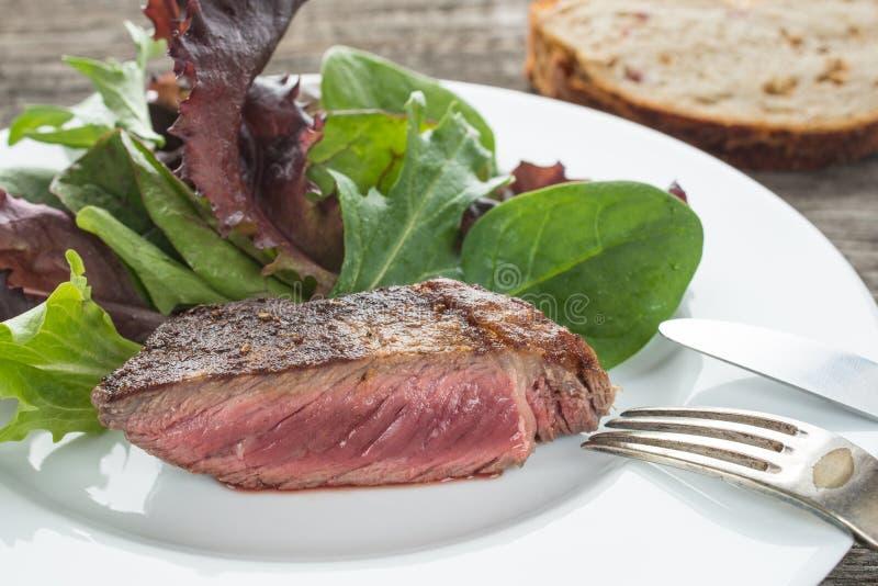 Bifteck rôti rare d'oeil de nervure photo stock