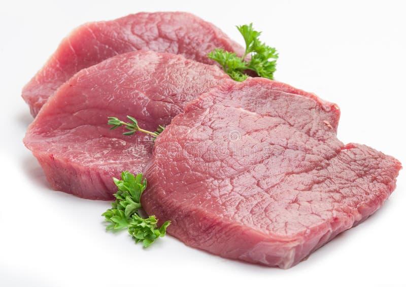 Biftecks crus de beaf avec le persil photo libre de droits