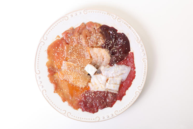 Biftecks crus de porc, viande hachée et glissières de jambon image stock
