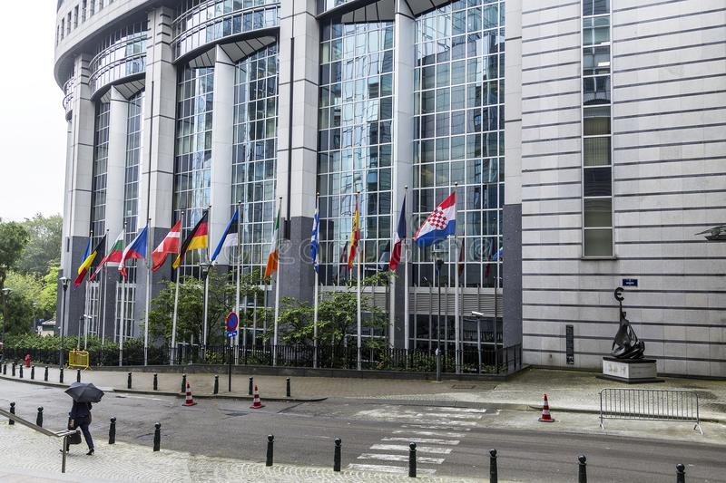 Big administrative building in Brussels / Belgium / 06.27.2016. The European Parliament. Editorial use only. Flags of European countries waving in the EU royalty free stock image
