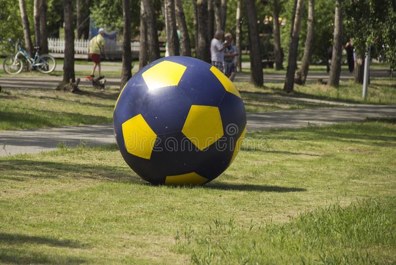 Big air soccer ball on the lawn stock photos