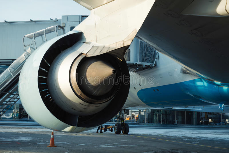 Big airplane boarding at the international airport royalty free stock photo