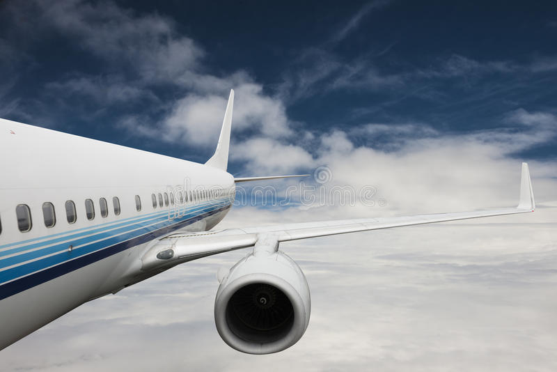 Big airplane in the sky stock photography