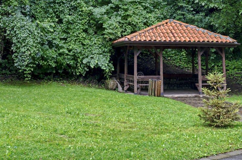 Big alcove and benches on the park Rila in rainy day. Near town Dupnitsa, Bulgaria stock photography