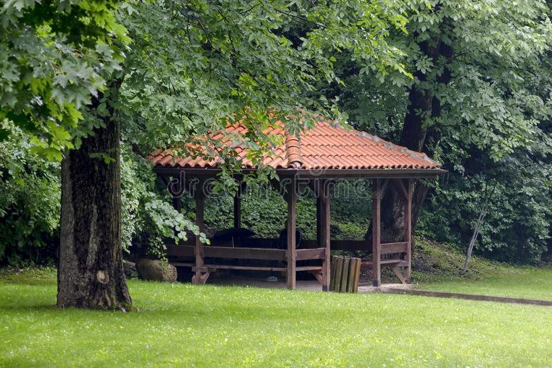 Big alcove and benches on the park Rila in rainy day near town Dupnitsa. Bulgaria stock images
