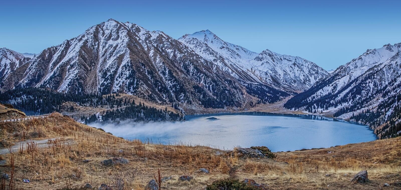 Big Almaty Lake in the early morning. Near Almaty, Kazakhstan stock images
