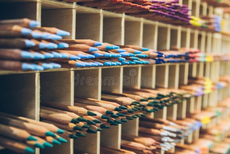 Big amount of pencils on the shelf. Close up stock photo